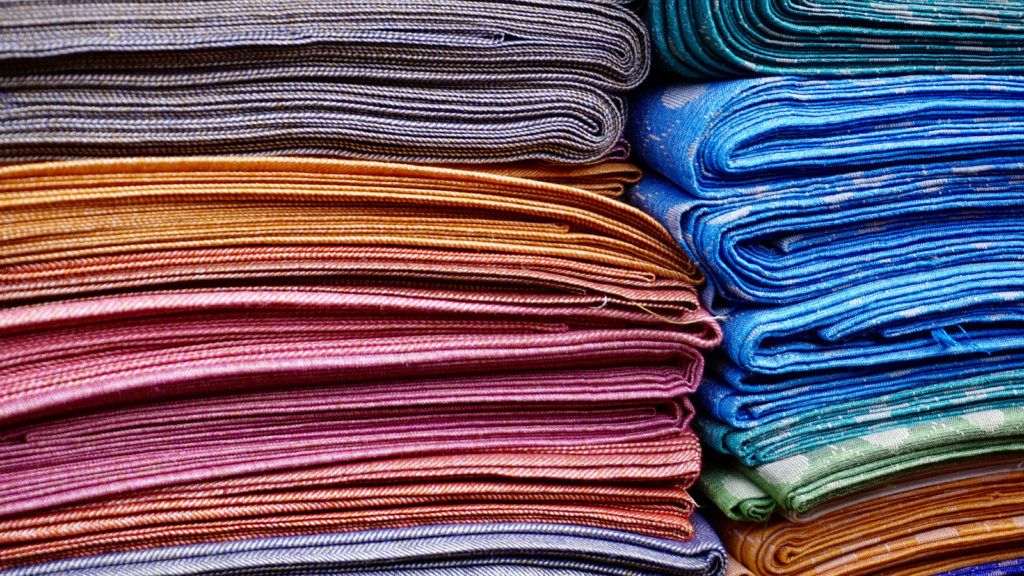 Canva Pile Of Area Rugs (1)